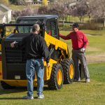 Jim Holland, Sales Representative (left), tried to sell the skid steer after he didn't win it.