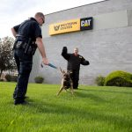 Officer Lee offers a reward for K9 Randy's obedience.