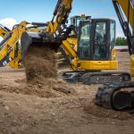 Moving dirt with the Mini Excavators.