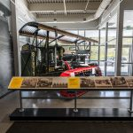 A restored Best Sixty crawler tractor sits in the lobby.