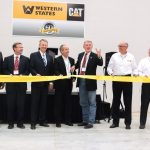 "Idaho Governor C.L. ""Butch"" Otter (hand raised) and CEO Tom Terteling (fourth from left) get set to cut the ribbon."