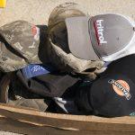 Quite a few Spokane visitors traded competitors' hats for Cat hats.