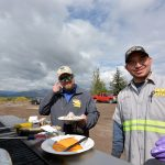 Jackson CRS Technician Enrique Rivera Lopez (left) grilled burgers and hot dogs to perfection.
